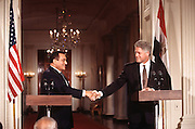 US President Bill Clinton shakes hands with Egyptian President Hosni Mubarak following a joint news conference July 31, 1996 in the White House East Room.