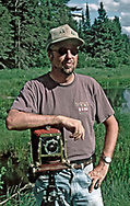 Tim Hawkins with his 4x5 field view camera at the University of Wisconsin Trout Lake Station, Vilas County, Wisconsin, 1995. (Photo by Dr. Matthew Ayres.)