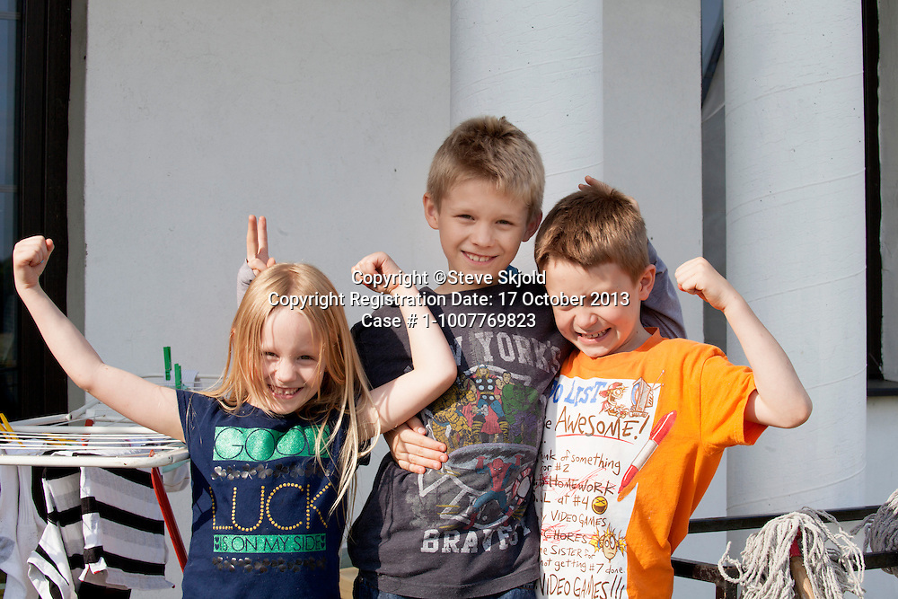 Three happy expressive Polish sibling children. Zawady Central Poland