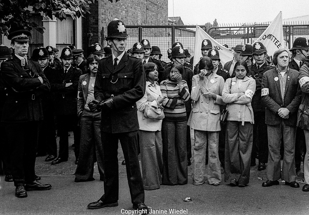 Asian women outside the Gates on strike against low pay and for union recognition at the Grunwick fFlm Processing plant in Willesden, Brent, London 1977