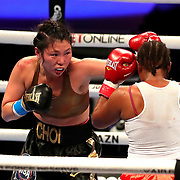 Hyun Mi Choi of South Korea punches Calista Silgado of Columbia during the undercard bout of the Gennady Golovkin versus Kamil Szeremeta world title fight at the Seminole Hard Rock Hotel and Casino in Hollywood, Florida USA on 18, Dec 2020. Photo: Alex Menendez