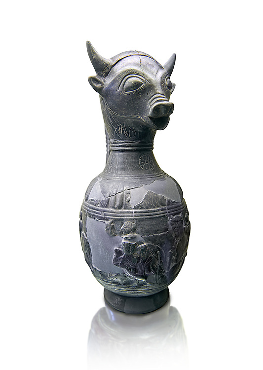 6th century BC Etruscan Bull headed bucherro style oinochoe, or wine jug,  made in Chuisi and excavated from the necropolis de Fonte Rotella, inv 3190, National Archaeological Museum Florence, Italy , white background .<br /> <br /> If you prefer to buy from our ALAMY PHOTO LIBRARY  Collection visit : https://www.alamy.com/portfolio/paul-williams-funkystock - Scroll down and type - Etruscan Florence - into LOWER search box. (TIP - Refine search by adding a background colour as well).<br /> <br /> Visit our ETRUSCAN PHOTO COLLECTIONS for more photos to download or buy as wall art prints https://funkystock.photoshelter.com/gallery-collection/Pictures-Images-of-Etruscan-Historic-Sites-Art-Artefacts-Antiquities/C0000GgxRXWVMLyc