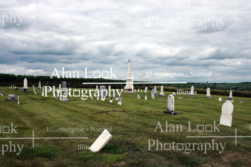 17 July 2009:  Hittle Grove cemetery, historical burial site of the Orndorff - Albright massacre of 1860, is located in Tazwell County Illinois.  ..About the massacre:..On the morning of the 12th of Oct. A.D. 1860, the husband and father in whose memory this monument is erected, was called away on business, from his residence three miles southeast of Delavan, Illinois. He left his family, consisting of his wife and two small daughters.  When he returned, no little ones ran to greet him, as was their custom. This caused alarm for the welfare of his dear ones.  Entering the house, he found his wife and daughters, whom he had left in perfect health and joyful spirits a few hours earlier.  They had been  murdered while he was absent. They were now lying prostrate and weltering in their blood.  The mother and younger daughter were already dead.  The older daughter was still living and moaning piteously but unable to whisper one word to her father.  At four o'clock the next morning, death ended her suffering.  Kind friends carried them in one coffin, to their last resting place...The murderer was a former hired hand. As he was robbing the family. He killed them in order to cover up the crime.  He was later found hiding in a corn crib in Logan County and was returned to Pekin where he became the first man to be hung in Tazewell County.  .