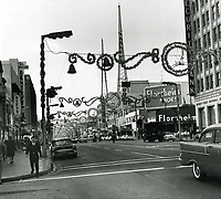 1961 Looking west on Hollywood Blvd. at Cahuenga Blvd. during Christmastime