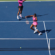 Serena Williams, (left) and Venus Williams, USA, in action during their victory over Black and Huber  during the Women's Doubles Final at  the US Open Tennis Tournament at Flushing Meadows, New York, USA, on Monday, September 14, 2009. Photo Tim Clayton.