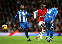 Photo: Tom Dulat/Sportsbeat Images.<br /> <br /> Arsenal v Wigan Athletic. The FA Barclays Premiership. 24/11/2007.<br /> <br /> Salomon Olembe (L), Denny Landzaat (R) of Wigan Athletic and Bacary Sagna of Arsenal in between them fights for the ball.