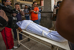 October 5, 2018 - Srinagar, Jammu and Kashmir, India - Neighbors and relatives carry the shroud covered body of one of the members of the regions oldest pro India political party, the National conference after he was killed by unidentified gunmen, on October 5, 2018 in Srinagar, the summer capital of Indian administered Kashmir, India.Two members of the regions oldest pro India political party, the National conference (NC), were shot dead while another was wounded by unidentified assailants in Karfali Mohalla area of summer capital city Srinagar. Local news agency reported that the militants attacked the close aides of NC Member Legislative Assembly for Habba Kadal constituency Shimami Firdous at Karfali Mohalla. The slain were identified as Mushtaq Ahmad Wani and Nazir Ahmed Wani. India has announced local body polls in the region from October 8 but major pro Indian parties Including the NC have  decided to boycott  the polls over what they term New Delhi's attempt to alter the demography of the disputed Himalyan region . (Photo by Kabli Yawar/Nur Photos) (Credit Image: © Kabli Yawar/NurPhoto/ZUMA Press)