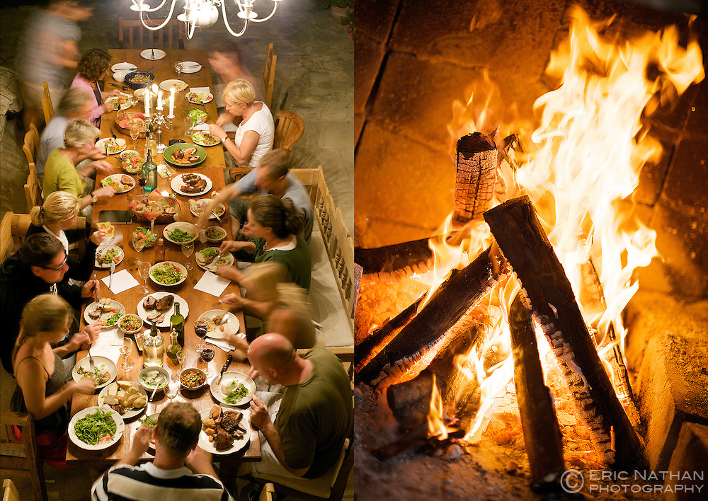 Large table with dinner guests in Lake Balaton, Hungary and fireplace at Kurland estate in Plettenberg Bay.