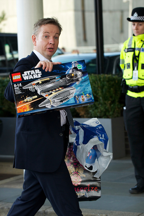 Secretary of State for Education Michael Gove arrives at his hotel holding up a box of star wars legos on the third, and penultimate, day of the Conservatives Party Conference at the ICC, Birmingham, England on October 5, 2010.  This is the first conference since the government coalition with the Liberal Democrats.