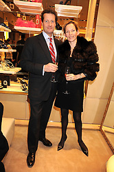 GILES & SARAH HACKING at a party at Roger Vivier, Sloane Street, London on 2nd December 2008.
