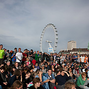 The audience listening and laughing at jokes by comedian Mark Thomas...The Health and Care Bill has been passed by Parliament and is due to go to the House of Lords. In protest against the bill which aim to deconstruct and privatise large parts of the NHS UK Uncut activists together with health workers and trade unionists blocked the Westminster Bridge from 1pm til 5.30pm.