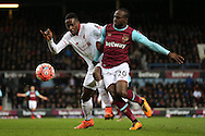 Victor Moses of West Ham United and Divock Origi of Liverpool compete for the ball. The Emirates FA cup, 4th round replay match, West Ham Utd v Liverpool at the Boleyn Ground, Upton Park  in London on Tuesday 9th February 2016.<br /> pic by John Patrick Fletcher, Andrew Orchard sports photography.