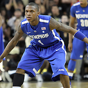Memphis guard Joe Jackson (1) defends during a Conference USA NCAA basketball game between the Memphis Tigers and the Central Florida Knights at the UCF Arena on February 9, 2011 in Orlando, Florida. Memphis won the game 63-62. (AP Photo: Alex Menendez)