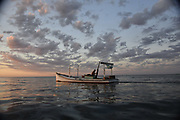 Crab fishernan's boat at sunrise