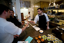Chef de Cuisine David Castro, right, greets one of his staff at Cala, the first U.S. restaurant from Mexican chef Gabriela Camara, Monday, April 4, 2016, in San Francisco, Calif. (Photo by D. Ross Cameron)