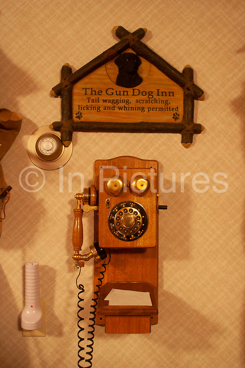 Hunter Byron Grubbs home is full of the guns, trophies, stuffed animals and hunting paraphernalia of an experienced hunter, near Minot, North Dakota, United States. Here, basement room an old telephone.