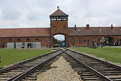 Rail track leading to the main entrance to Auschwitz II (Birkenau) Nazi concentration camp, in Auschwitz, Poland on September 3, 2017. Auschwitz concentration camp was a network of German Nazi concentration camps and extermination camps built and operated by the Third Reich in Polish areas annexed by Nazi Germany during WWII. It consisted of Auschwitz I (the original camp), Auschwitz II–Birkenau (a combination concentration/extermination camp), Auschwitz II–Monowitz (a labor camp to staff an IG Farben factory), and 45 satellite camps. In September 1941, Auschwitz II–Birkenau went on to become a major site of the Nazi Final Solution to the Jewish Question. From early 1942 until late 1944, transport trains delivered Jews to the camp's gas chambers from all over German-occupied Europe, where they were killed en masse with the pesticide Zyklon B. An estimated 1.3 million people were sent to the camp, of whom at least 1.1million died. Around 90 percent of those killed were Jewish; approximately 1 in 6 Jews killed in the Holocaust died at the camp. Others deported to Auschwitz included 150,000 Poles, 23,000 Romani and Sinti, 15,000 Soviet prisoners of war, 400 Jehovah's Witnesses, and tens of thousands of others of diverse nationalities, including an unknown number of homosexuals. Many of those not killed in the gas chambers died of starvation, forced labor, infectious diseases, individual executions, and medical experiments. In 1947, Poland founded a museum on the site of Auschwitz I and II, and in 1979, it was named a UNESCO World Heritage Site. Photo by Somer/ABACAPRESS.COM