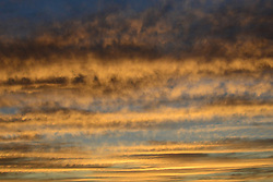 Clouds capture the golden sunset at Bras D'Or.