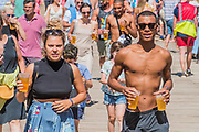 The heat encourages stripping off, eating lollies and drinking beers - The 2018 Latitude Festival, Henham Park. Suffolk 15 July 2018
