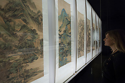 © Licensed to London News Pictures. 23/10/2013. London, UK. A member of Victoria and Albert Museum staff views 'Landscapes in the Manner of Old Master' (1669-73) a panorama by Wang Jian at the press view for 'Masterpieces of Chinese Painting 700 - 1900' at the museum in London today (23/10/2013). The exhibition, running from the 26th of October 2013 to the 19th of January 2014, features some of the finest examples of Chinese painting created over a 1200 year period. Photo credit: Matt Cetti-Roberts/LNP