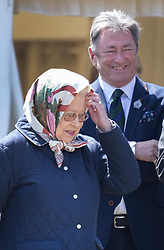 © Licensed to London News Pictures. 10/05/2017. Windsor, UK. Queen Elizabeth II stands with Alan Titmarsh as she watches a competition at the Royal Windsor Horse Show. The five day equestrian event takes place in the grounds of Windsor Castle. Photo credit: Peter Macdiarmid/LNP