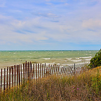"""""""When the Boughs Bend""""<br /> <br /> A strong wind storm bends the pine trees, snow fence,grasses, and wildflowers along Lake Michigan!!<br /> <br /> The Great Lakes by Rachel Cohen"""