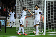 Swansea city's Wayne Routledge (L) celebrates with Michu after he scores the 1st goal.   Europa league group A match, Swansea city v FC St. Gallen at the Liberty Stadium in Swansea, South Wales on Thursday 3rd October 2013. pic by Andrew Orchard , Andrew Orchard sports photography,