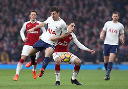 Tottenham Hotspur's Ben Davies (left) and Arsenal's Hector Bellerin battle for the ball during the Premier League match at the Emirates Stadium, London.