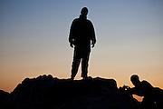Zach Podell-Eberhardt takes a picture of Henry standing on a rock at sunset on the West Coast Trail, British Columbia, Canada.