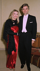 MISS CINDY JACKSON, she has had most of her body altered by plastic surgery and MR ANDREW SHEEPSHANKS, at a party in London on 9th October 1997.MBZ 25
