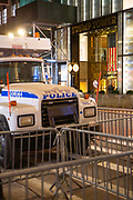 New York, NY - 3 November 2020. New York City anticipates presidential election results as polls in some states close. A police barricade formed my sanitation department trucks and police busses blocks access to Trump Tower on Fifth Avenue.g