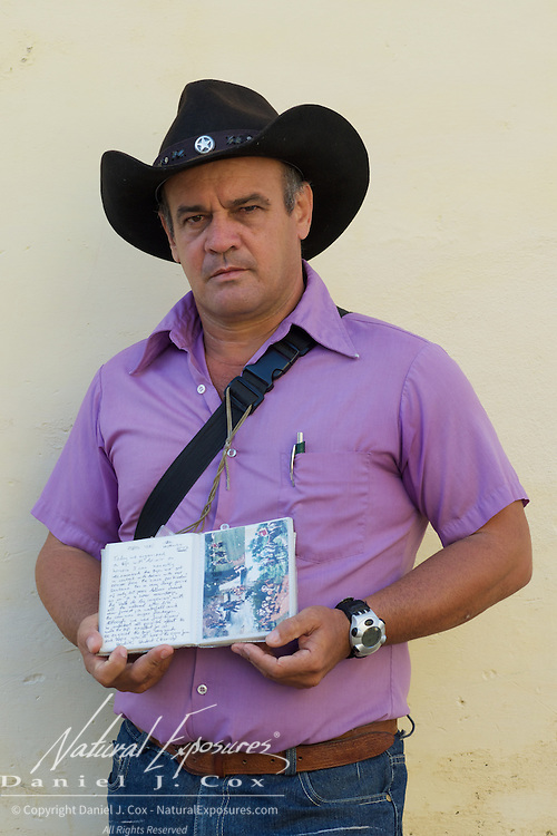 A local Cuban man that was selling coal, stops for a momment  on the streets of Trinidad, Cuba.