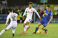 AFC Wimbledon midfielder Anthony Hartigan (26) dribbling during the EFL Sky Bet League 1 match between AFC Wimbledon and Walsall at the Cherry Red Records Stadium, Kingston, England on 25 November 2017. Photo by Matthew Redman.