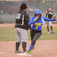 Zuni Thunderbird Shierra Brown (3) sprints around third base as Navajo Pine Warrior Tori Brown (18) waits for the throw from left field Friday at Tohatchi High School.