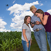 Harrah High School FFA student Tyler Thomason flies a drone over a corn field as Baylee Rooks, left, and Lexi Malaske watch outside Harrah, Oklahoma. The FFA program receive a grant to purchase the drone so they can teach students to survey agricultural field with the new technology. Nathan Lambrecht/Journal Communications