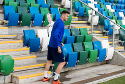 Northern Ireland striker Kyle Lafferty places a cardboard cutout in the dugout of Northern Ireland manager Michael O'Neill during the training session at Windsor Park, Belfast.