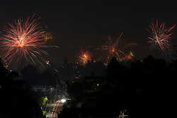 Unauthorized fireworks light up the night sky over Oakland, Calif., Saturday, July 4, 2020, as the nation celebrates the 244th anniversary of independence from England. Most municipal fireworks shows were cancelled due to the coronavirus pandemic. (Photo by D. Ross Cameron)