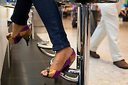 Lady's legs and designer shoes at Caviar House & Prunier at Heathrow airport's Terminal 5