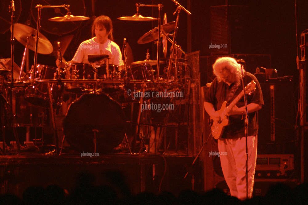 """Mickey Hart & Jerry Garcia performing with The Grateful Dead Live at The Hampton Coliseum on 9 October 1989. One of the """"Formerly The Warlocks"""" concerts. Limited Edition Photographic Prints available for purchase in Cart."""