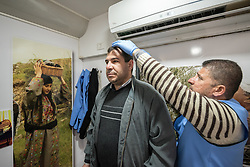 26 February 2020, Abu Dis, Palestine: Supervisor Ziad Paradiah (right) takes the height of 43-year-old Ayyad from Abu Dis, in order to calculate his body-mass index. In an effort to make Diabetes services more accessible to people in the West Bank, the Augusta Victoria Hospital offers a Mobile Diabetes Clinic, which moves around to various locations in the West Bank, offering screening and routine testing for Diabietes and the symptoms it causes.