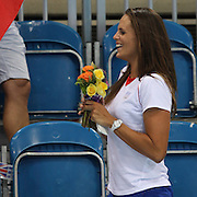 Laure Manaudou with the flowers from brother Florent Manaudou, France, winner of the Gold Medal in the 50m Freestyle Final  at the Aquatic Centre at Olympic Park,  during the London 2012 Olympic games. London, UK. 3rd August 2012. Photo Tim Clayton
