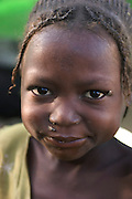 (MODEL RELEASED IMAGE). Five year old Mariam Aboubakar in the Breidjing Refugee Camp, Eastern Chad on the Sudanese border, which shelters 30,000 people who have fled their homes in Darfur, Sudan. (Supporting image from the project Hungry Planet: What the World Eats.)