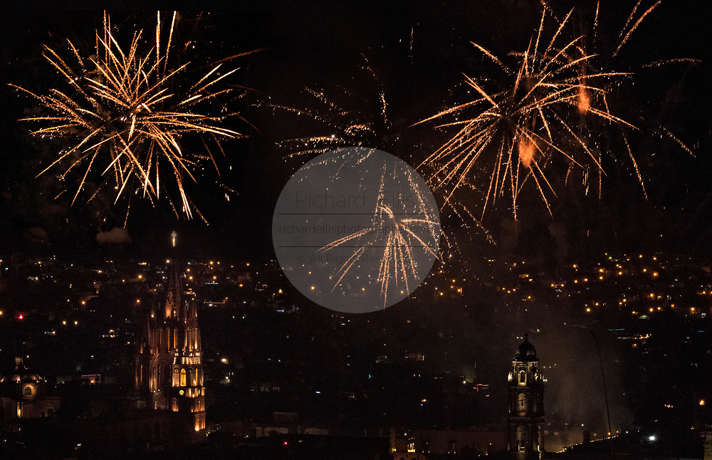 Fireworks explode over the the colonial center on the stoke of midnight celebrating the New Year January 1, 2018 in San Miguel de Allende, Mexico.