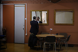 """© London News Pictures. """"Looking for Nigel"""". A body of work by photographer Mary Turner, studying UKIP leader Nigel Farage and his followers throughout the 2015 election campaign. PICTURE SHOWS - NIgel Farage rehearses his speech before a large public meeting, in a private room at the Carn Brae Leisure Centre in Penzance, Cornwall, on March 6th 2015. Mr Farage spent a long weekend in the South West speaking to the more elderly population in Cornwall and Devon. . Photo credit: Mary Turner/LNP **PLEASE CALL TO ARRANGE FEE** **More images available on request**"""