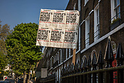 Sign supporting peoples health before profit in front of an Islington house during the coronavirus pandemic on the 24th April 2020 in London, United Kingdom.