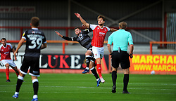 Tyler Frost of Crawley Town and Charlie Raglan of Cheltenham Town compete for the highball - Mandatory by-line: Nizaam Jones/JMP - 10/10/2020 - FOOTBALL - Jonny-Rocks Stadium - Cheltenham, England - Cheltenham Town v Crawley Town - Sky Bet League Two