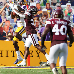 Sep 26, 2020; Baton Rouge, Louisiana, USA; LSU Tigers wide receiver Jaray Jenkins (10) catches a pass over Mississippi State Bulldogs safety Fred Peters (38) during the first half at Tiger Stadium. Mandatory Credit: Derick E. Hingle-USA TODAY Sports