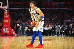 December 21, 2018 - Los Angeles, CA, U.S. - LOS ANGELES, CA - DECEMBER 20: Dallas Mavericks Guard Luka Doncic (77) looks to make a pass during a NBA game between the Dallas Mavericks and the Los Angeles Clippers on December 20, 2018 at STAPLES Center in Los Angeles, CA. (Photo by Brian Rothmuller/Icon Sportswire) (Credit Image: © Brian Rothmuller/Icon SMI via ZUMA Press)
