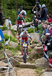© licensed to London News Pictures. Pickering, UK. 20/05/11. Jaroslav Kulhavy of Specialized Racing takes the rock garden route during the men's elite race. It paid of as he won with a 50 second lead. 2011 UCI Mountain Bike Cross-Country World Cup at Dalby Forest. Please see special instructions for usage rates. Photo credit should read: Reuben Tabner