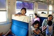 A family travels on the Circular Railway on 19th March 2016 in Yangon, Myanmar. The Circular Railway is a 28.5 mile 45.9 km 39 station British built loop system that connects Yangon to its satellite towns and villages.